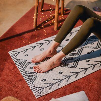 Yogamåtte i forskellige designs