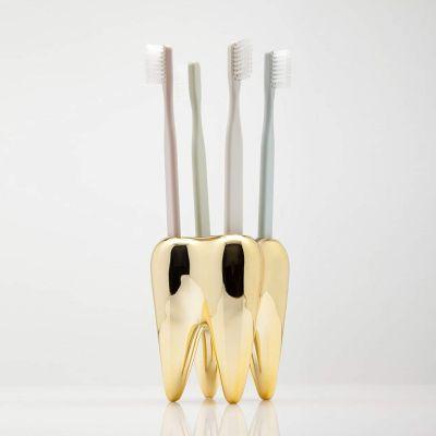 Tandbørsteholder Tand i guld